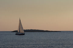 Sailing in sunset Royalty Free Stock Photography
