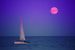 Sailing boat and full moon Royalty Free Stock Images