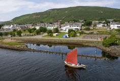 Sailing Boat Going Passed Helmsdale Old Harbour, Helmsdale, Sutherland, Scotland, U.K Stock Photography