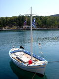 Sailing Boat Greece. Small white and blue sailing boat in the marina of Galaxidi Greece royalty free stock photo