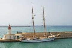 Sailing boat at harbor. On blue ocean Stock Photo
