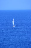 Sailing boat heading to the sea Royalty Free Stock Images