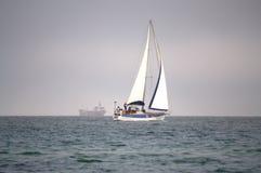 Sailing boat the high seas. Many sailing yachts race .Picture taken on May 1st,2014 at  Varna bay,Bulgaria,Black sea coast Royalty Free Stock Image