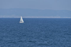 Sailing boat on the high seas Royalty Free Stock Photo