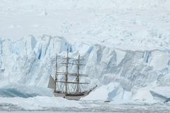 Sailing boat in the ice Royalty Free Stock Photos