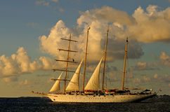 Sailing boat. This image was taken as the sail boat was leaving the harbour, filled with guests, sailing to some exotic place Royalty Free Stock Photos