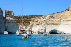 Sailing boat and kayakers exploring Kleftiko, Melos, Greece Stock Photography