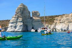 Sailing boat and kayakers exploring Kleftiko, Melos, Greece Royalty Free Stock Image