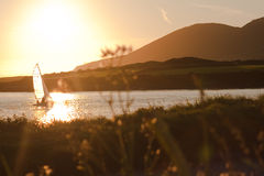 Sailing boat kissed by the sun in Ireland Royalty Free Stock Photo
