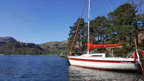 Boat anchored on lake ullswater. Sailing boat lake district stock images
