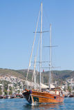 Sailing boat leaving Bodrum Marina, Turkey. Turkish sailing boat leaving Bodrum harbour , Turkey Stock Image