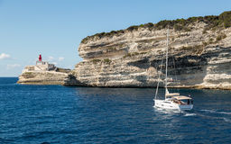 Sailing boat leaving Bonifacio harbour in south Corsica Royalty Free Stock Photos