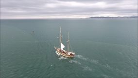 Sailing boat leaving port. Poolbeg. Dublin. Ireland stock footage