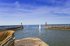 Sailing boat leaving Whitby Harbour Stock Photos