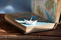 Sailing boat and map. Royalty Free Stock Photo