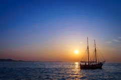 Sailing boat on the Mediterranean sea at the sunset Stock Image