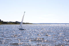 Sailing boat in the middle of a lake Royalty Free Stock Images