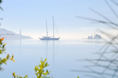 Sailing boat in the misty morning Stock Photography
