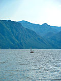 Sailing Boat on a Mountain Lake Royalty Free Stock Photography