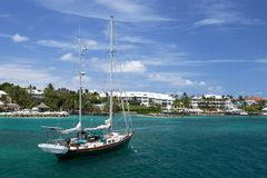 Sailing Boat, Nassau Harbour, the Bahamas. A yacht with furled sails lies in Nassau Harbour with Paradise Island in the background stock photography