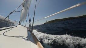 Sailing boat navigating with open sails  at the Mediteranean sea. Boats in sailing regatta. stock video