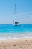 Sailing Boat Near Sandy Beach Stock Photo