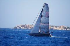 Sailing boat near the Sardinia coast. Royalty Free Stock Photos