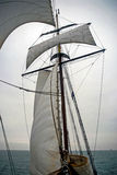 Sailing boat on Northern Sea sails wind water storm royalty free stock photos