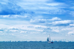 Sailing Boat on Open Blue Sea Stock Image