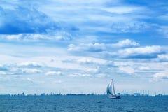 Sailing Boat on Open Blue Sea Stock Image