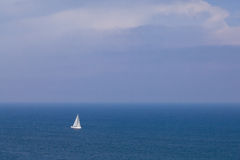 Sailing boat in open blue sea Royalty Free Stock Image