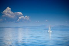 Sailing boat at an open sea
