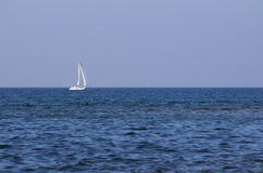 Sailing boat on the open sea. Royalty Free Stock Images