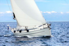 Sailing boat on open sea sailing on port tacks Royalty Free Stock Photos
