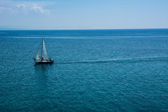 Sailing boat at an open sea Royalty Free Stock Photos