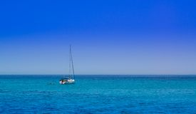 Sailing boat on the open sea Royalty Free Stock Photos