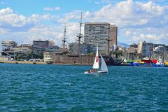 A Sailing Dinghy In Alicante Harbour Stock Photography