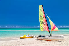 Sailing boat and pedal boat stand under bright sun Royalty Free Stock Image