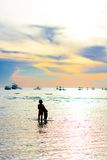 Sailing boat and people at the sunset Royalty Free Stock Photos