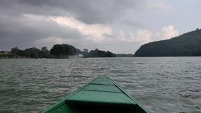 Sailing on a boat. In Phewa Lake of Pokhara, Nepal stock video footage