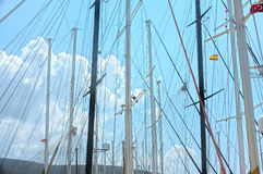 Sailing boat poles. Erected under the blue sky in Bodrum, Turkey Stock Photos