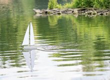 Sailing boat in a pond Royalty Free Stock Photography