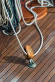 Closeup of pulley and rope on old sailing ship royalty free stock photography