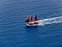 Sailing boat, red sails, aerial. Sailing boat with red sails, aerial view royalty free stock image