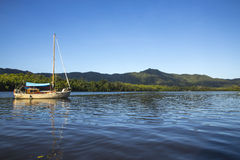 Sailing Boat At The River Stock Photo