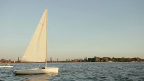 Sailing boat rocking on the lake stock video footage