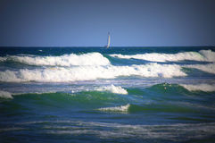 Sailing boat in rough sea Royalty Free Stock Images