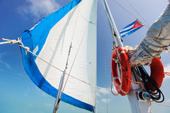 Sailing boat. Sail of a sailing boat against a blue sky Stock Images