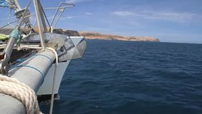 Sailing boat sailing along the coast stock video footage