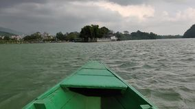 Sailing on a boat. In Phewa Lake of Pokhara, Nepal stock footage